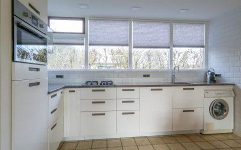 Uitgebreide keuken, met gakookplaat, magnetronoven en Quooker